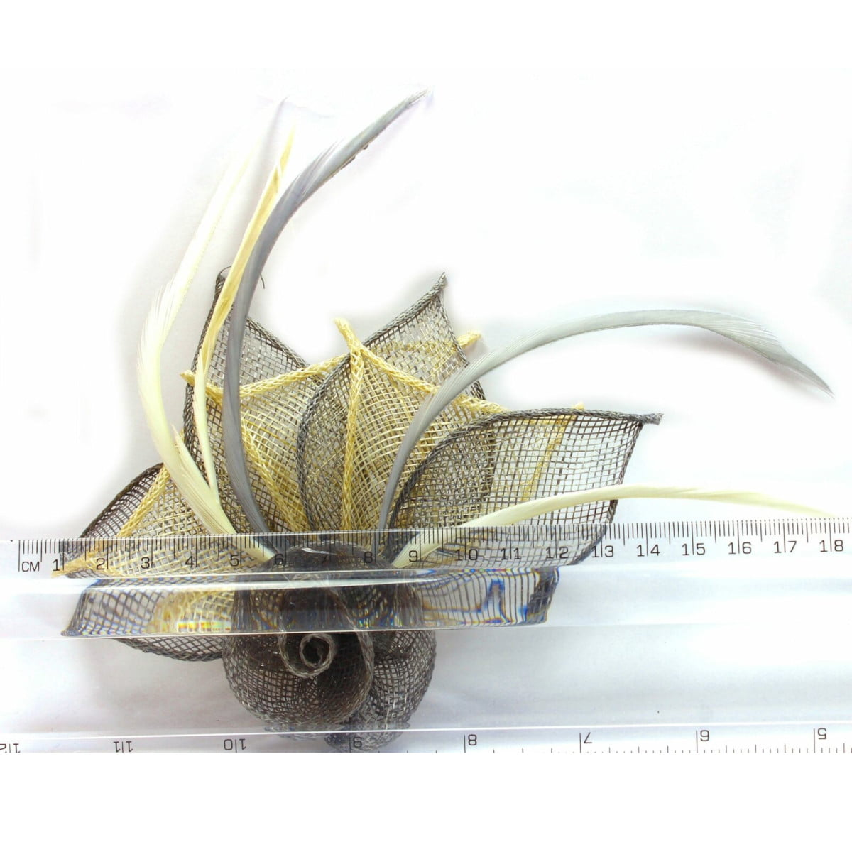 Grey and cream fascinator with hessian rose, petals, and feather tendrils (beak and pin) ruler