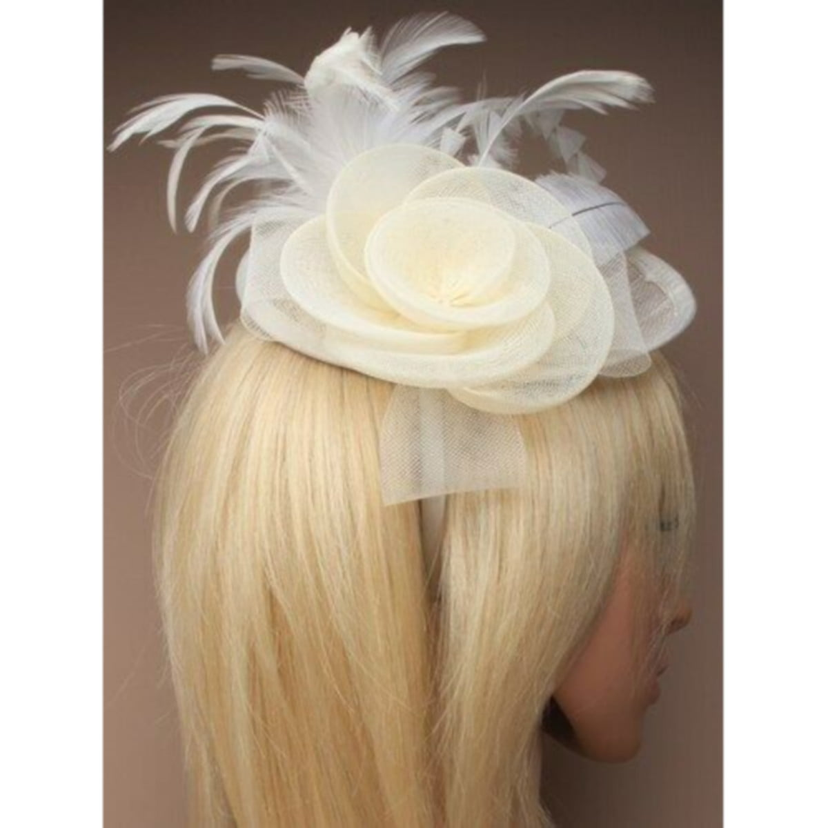 Ladies cream fascinator. Simulated net flower and feathers on an alice band. 1