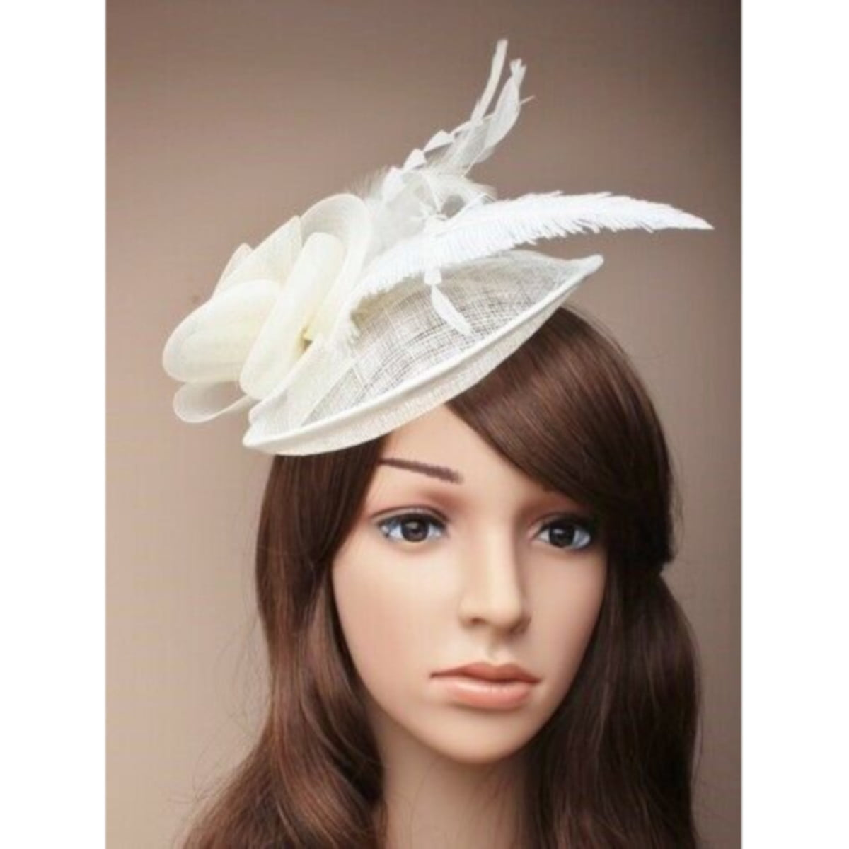 Ladies cream fascinator. Simulated net flower and feathers on an alice band. 3