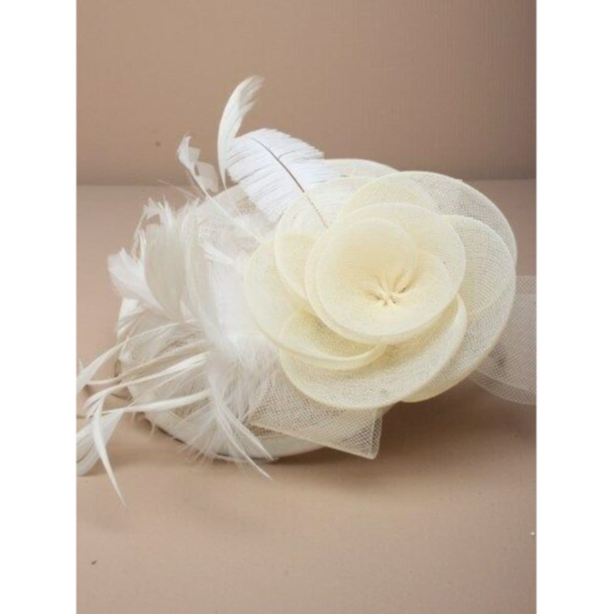 Ladies cream fascinator. Simulated net flower and feathers on an alice band. 2