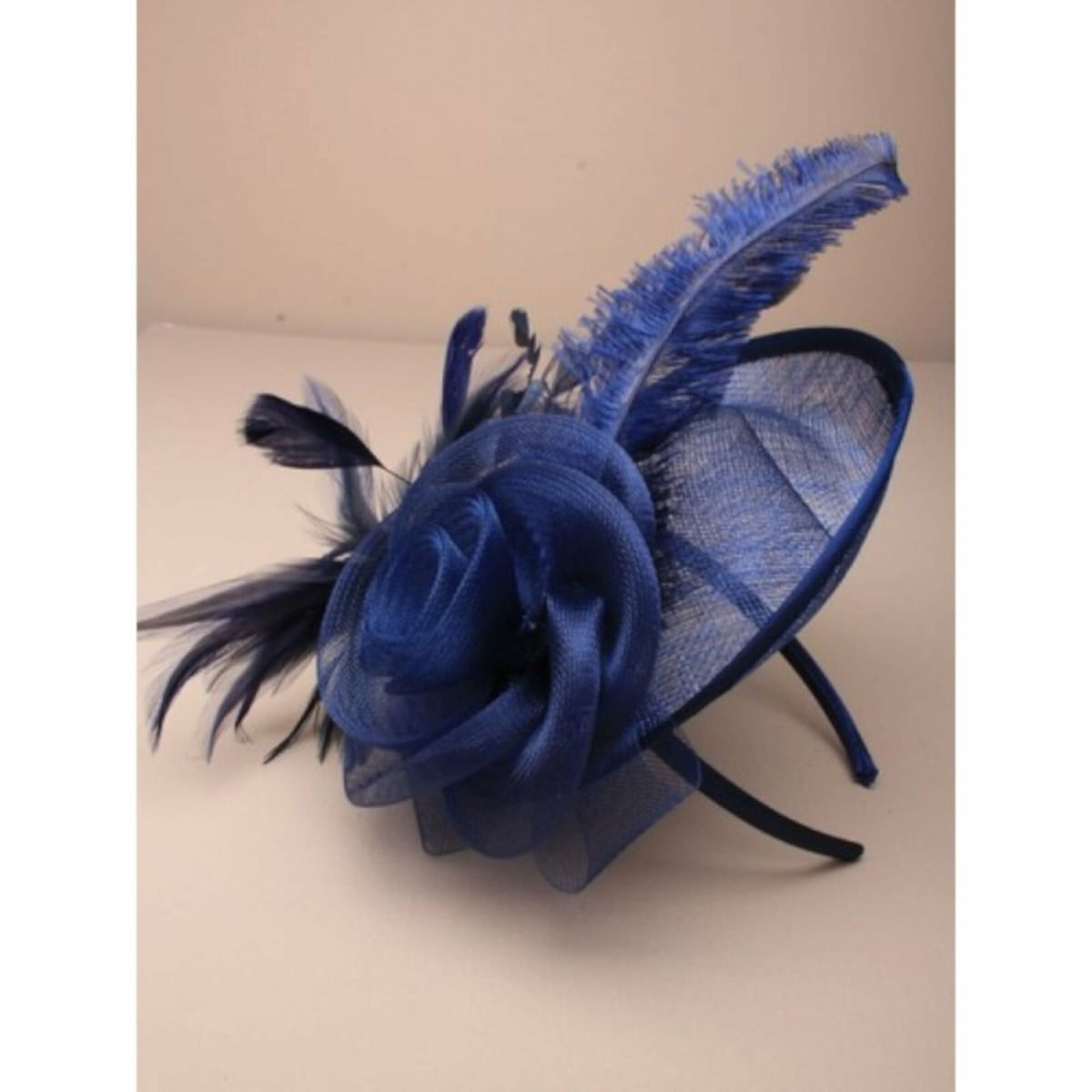 Ladies navy blue fascinator on self coloured alice band. Simulated flower and feather tendrils. 3