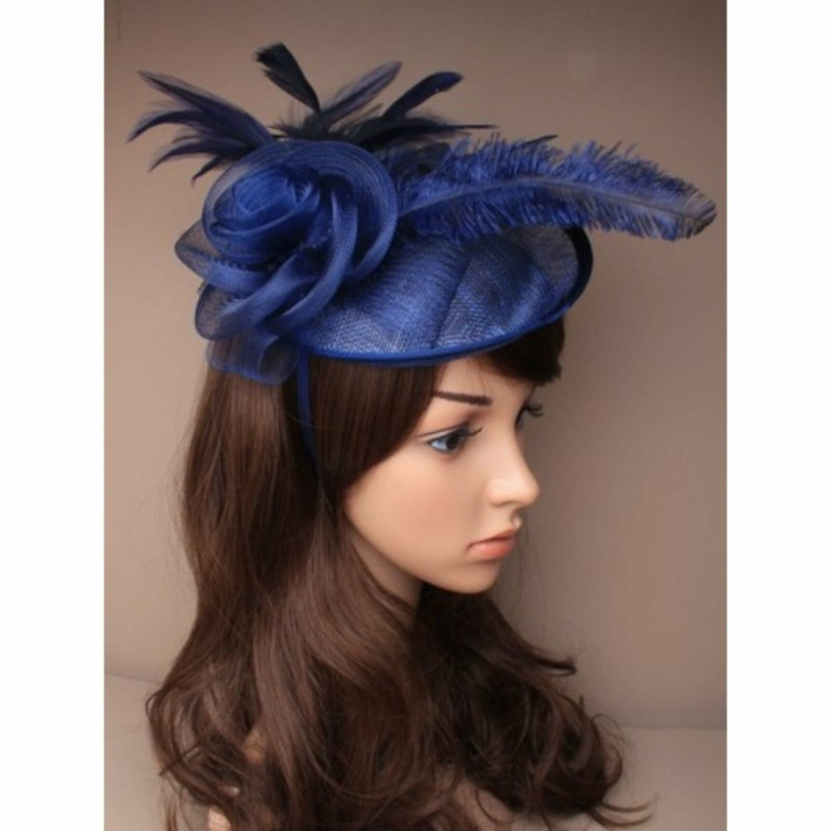 Ladies navy blue fascinator on self coloured alice band. Simulated flower and feather tendrils. 2