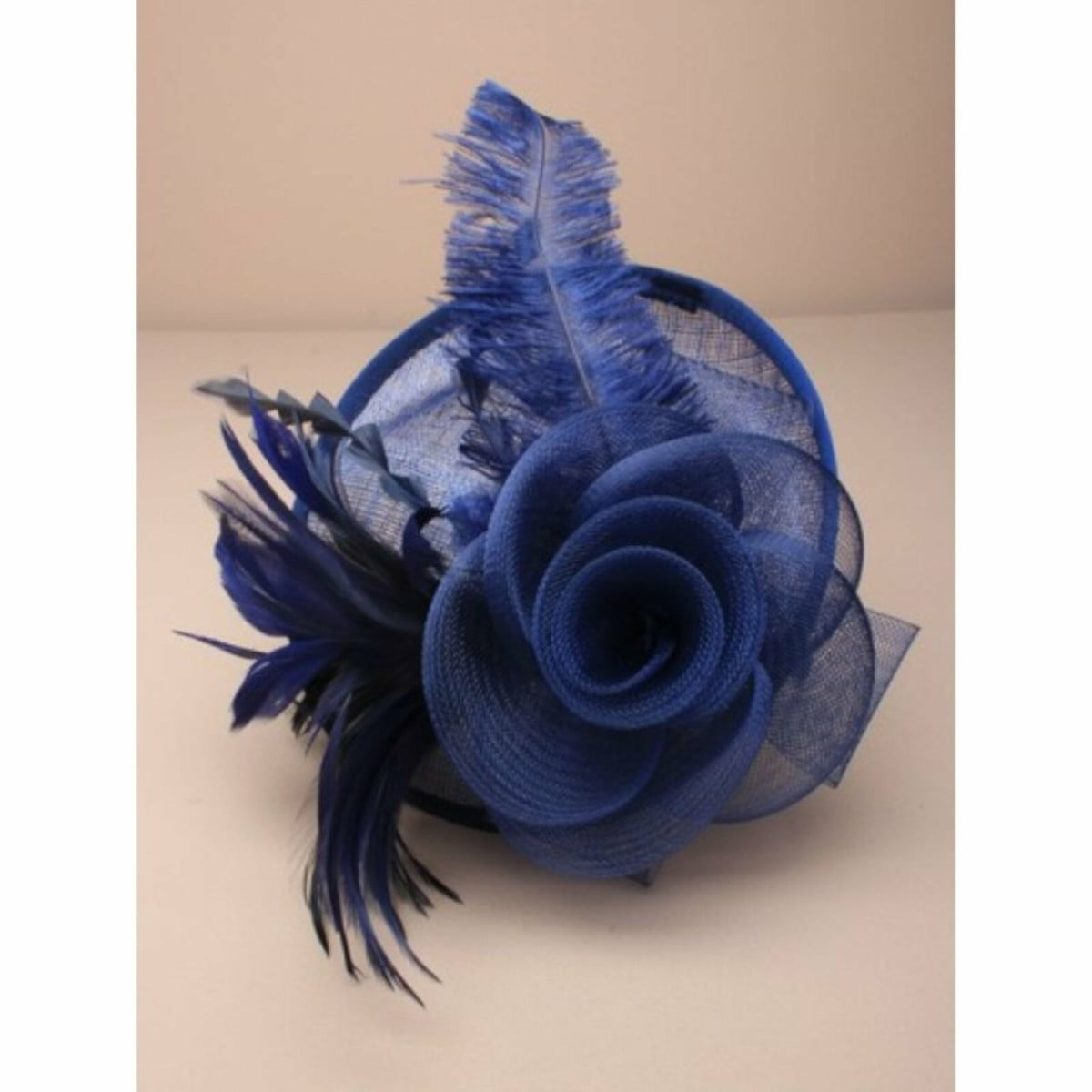 Ladies navy blue fascinator on self coloured alice band. Simulated flower and feather tendrils. 1