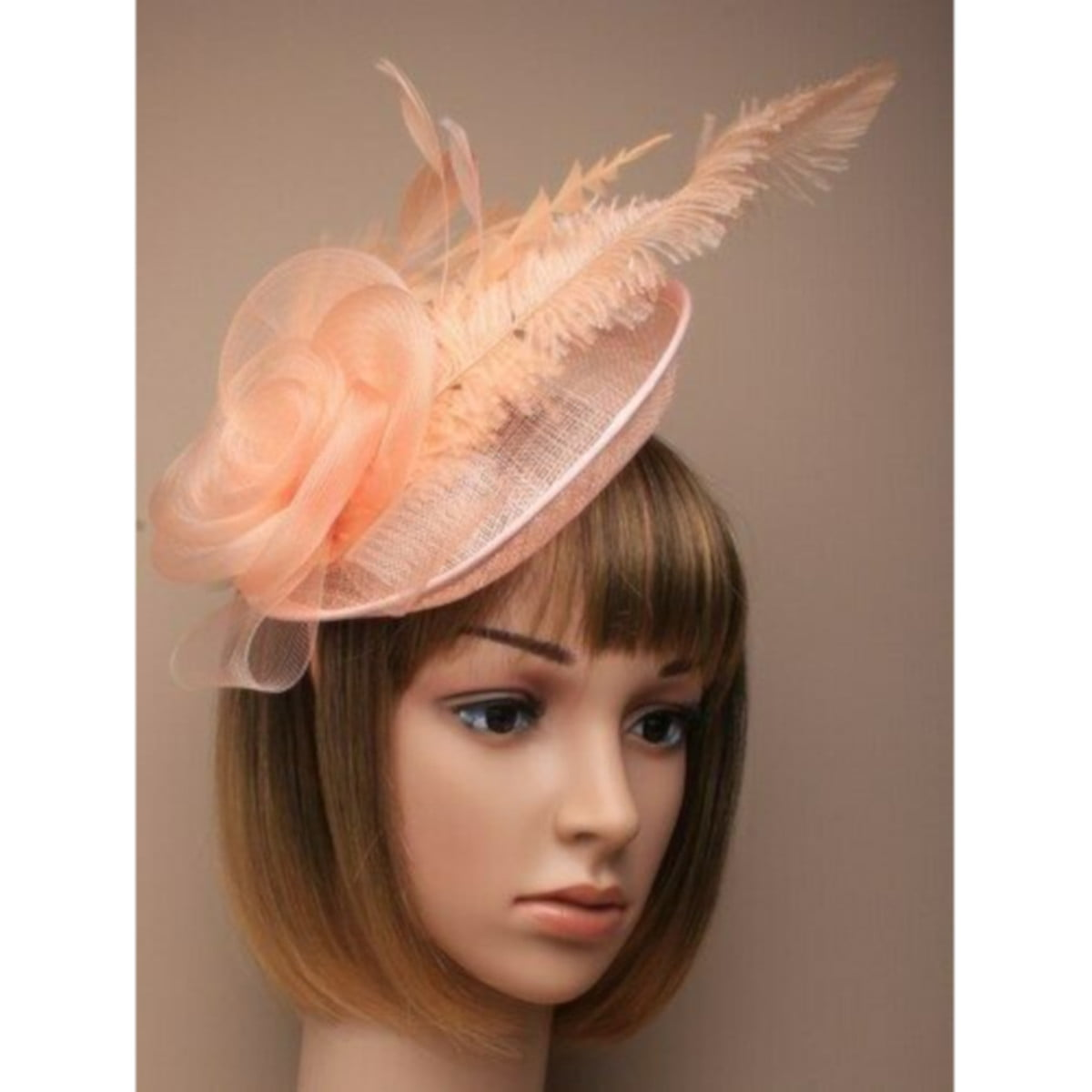Ladies peach fascinator on alice band. With feathers and net flower. 1