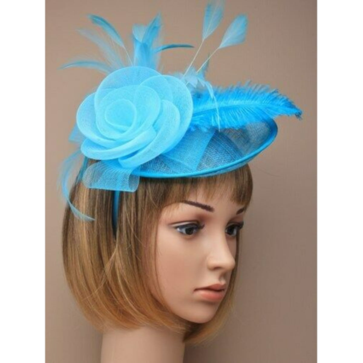 Ladies aqua fascinator with feathers and flower on alice band.