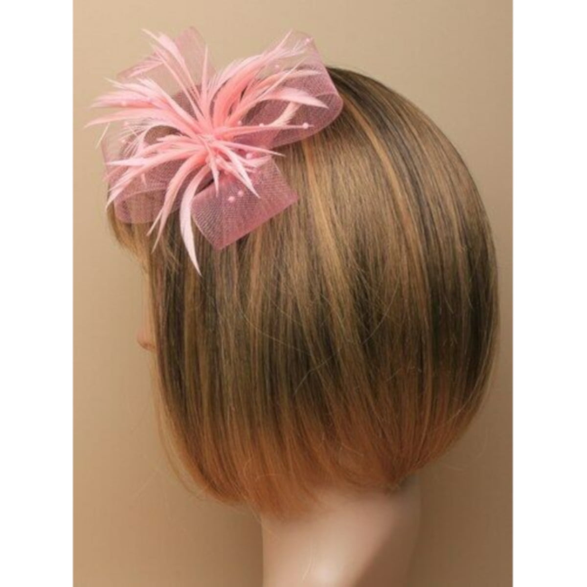 Pink fascinator with net loops and feathers. Beak clip and pin fastenings. 3