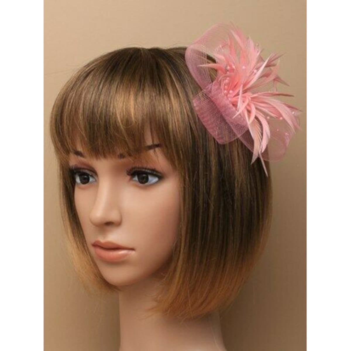 Pink fascinator with net loops and feathers. Beak clip and pin fastenings. 2