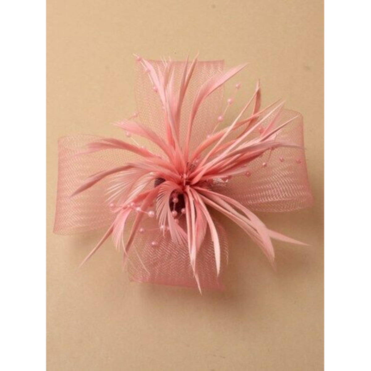 Pink fascinator with net loops and feathers. Beak clip and pin fastenings. 1