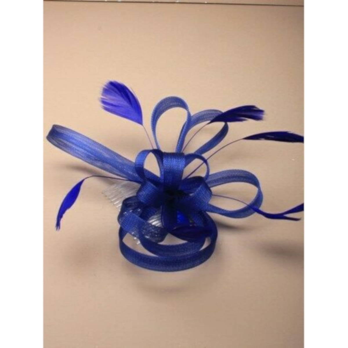 Royal blue fascinator with loops and feathers on clear comb. 2