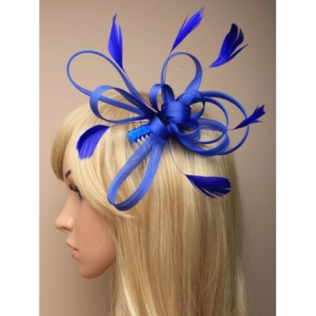 Royal blue fascinator with loops and feathers on clear comb. 1