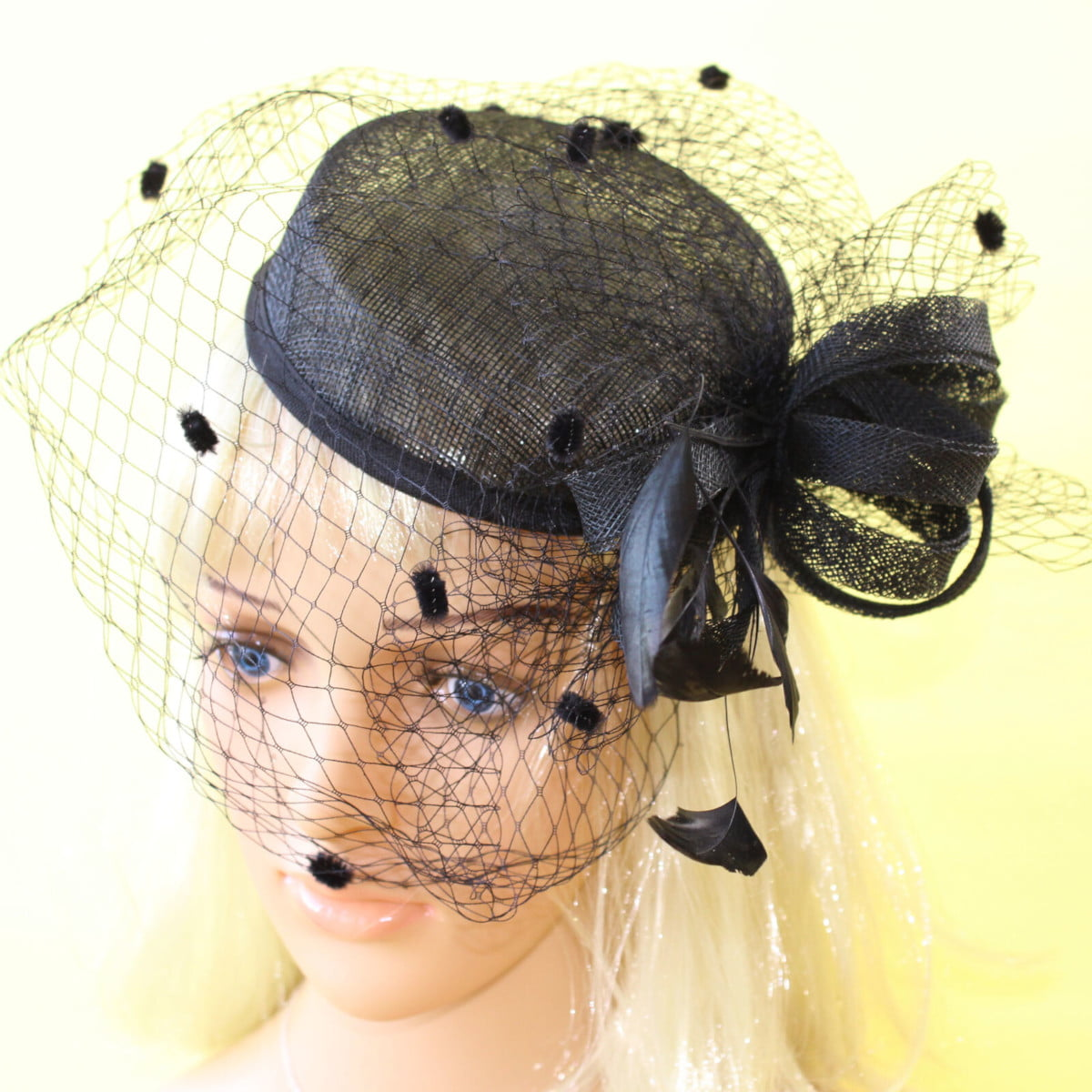 Black sinamay fascinator with bows and netting on elastic