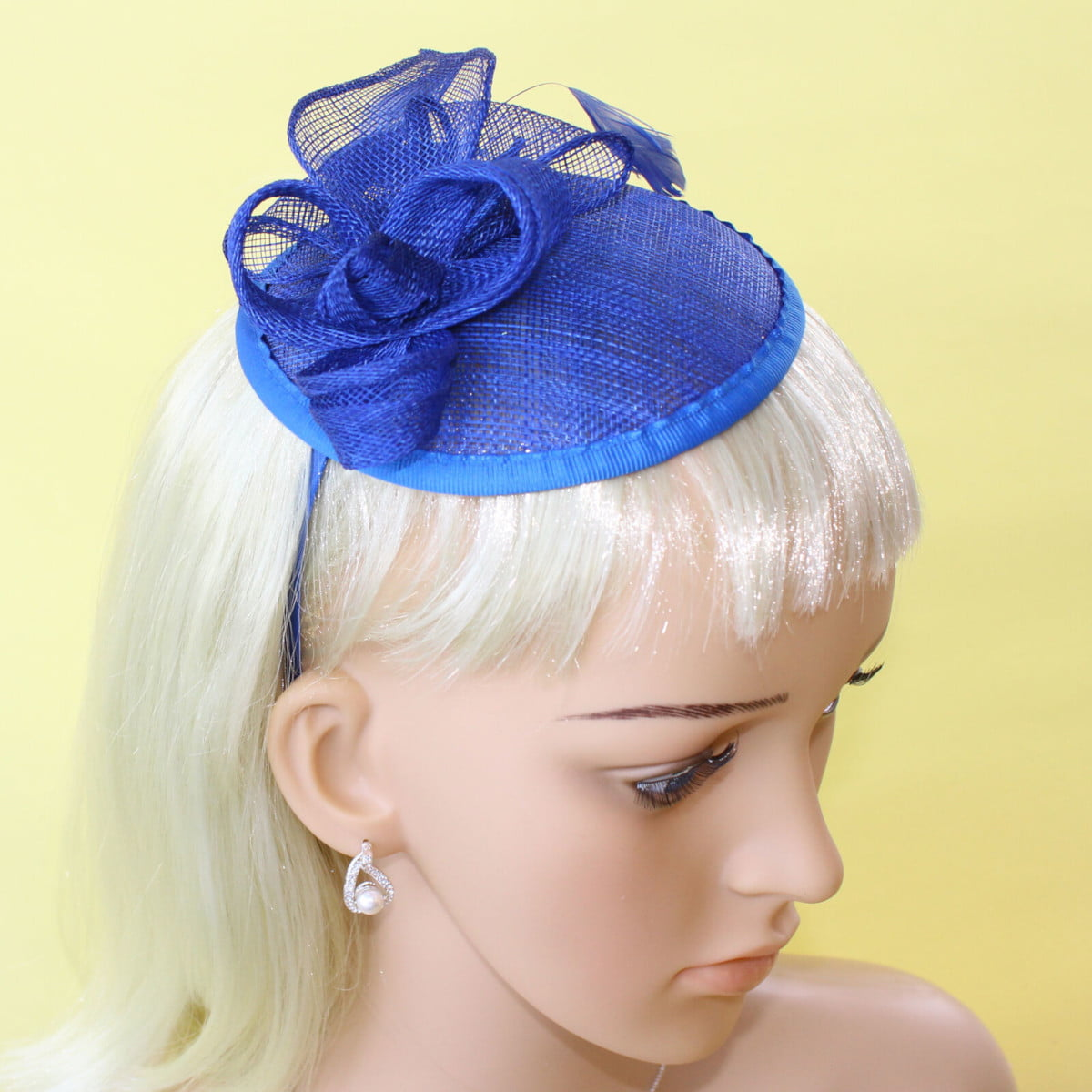 Royal blue hessian fascinator on alice band.