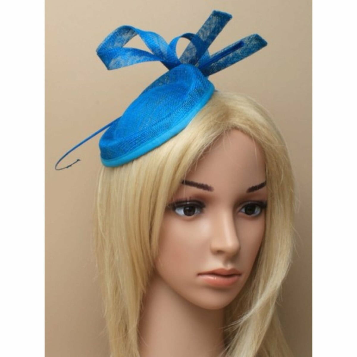Teal fascinator with Ostrich quill on self coloured aliceband
