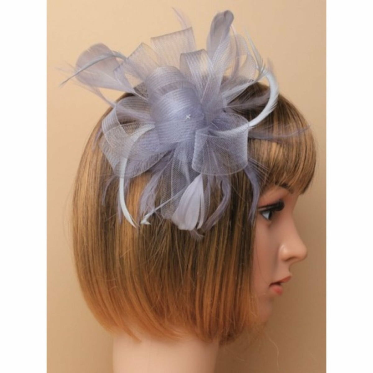 Silver grey looped net fascinator on a clear comb