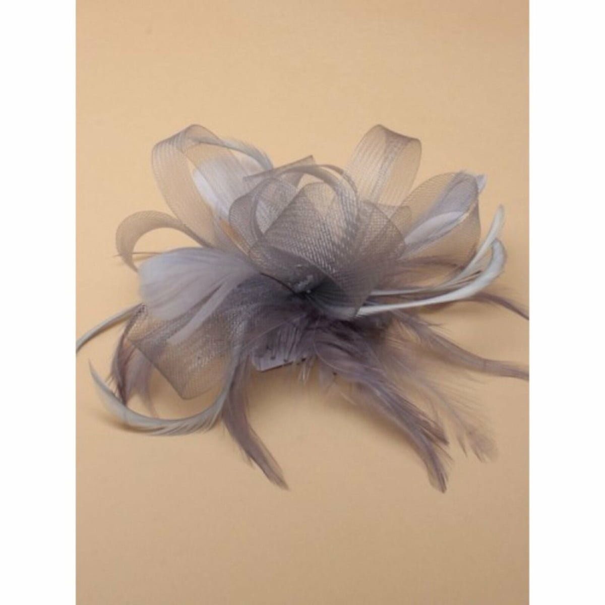 Silver grey looped net fascinator on a clear comb 1