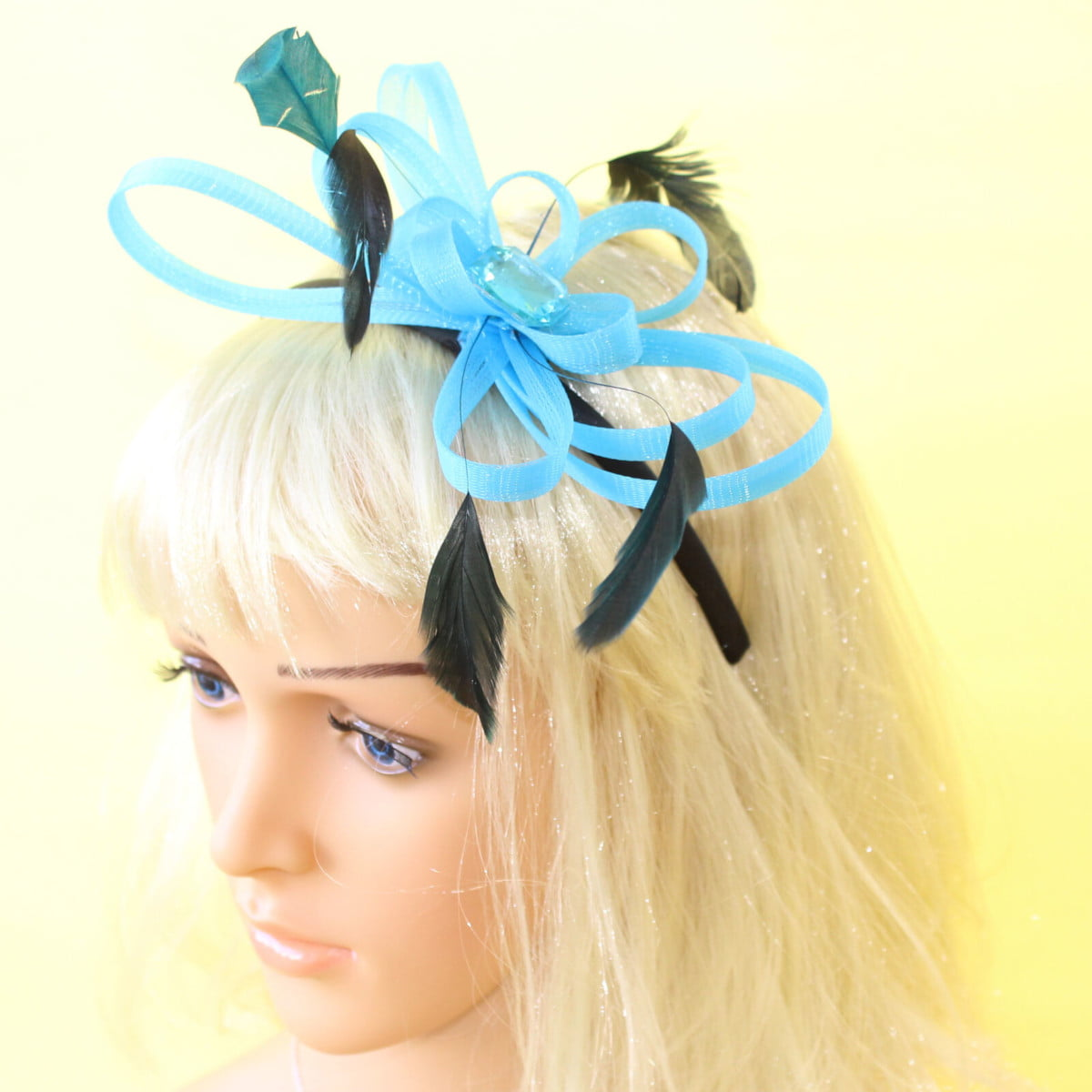 Aqua fascinator with looped ribbon, black feathers and gem on black aliceband