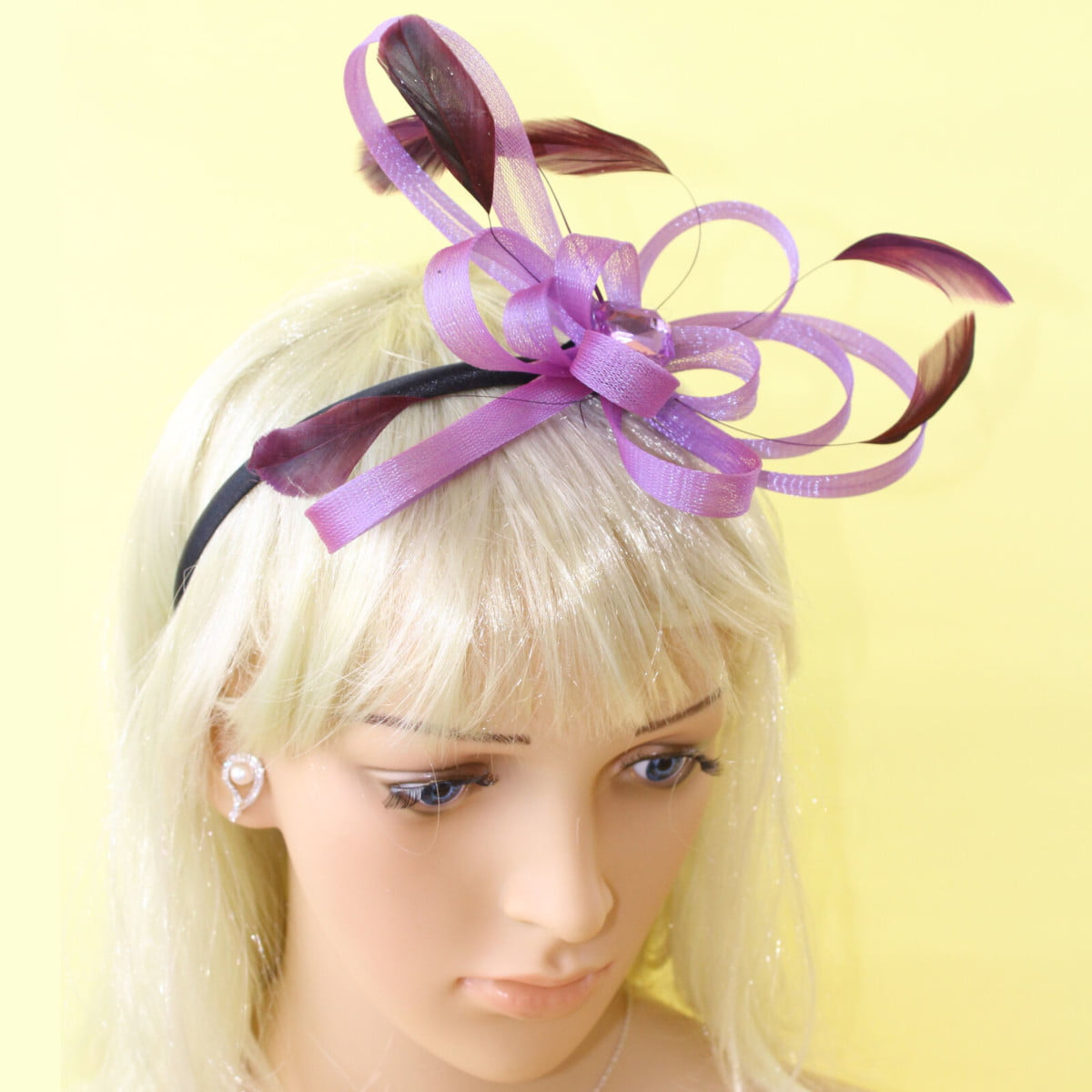 Purple fascinator with looped ribbon, black feathers and gem on black aliceband 1