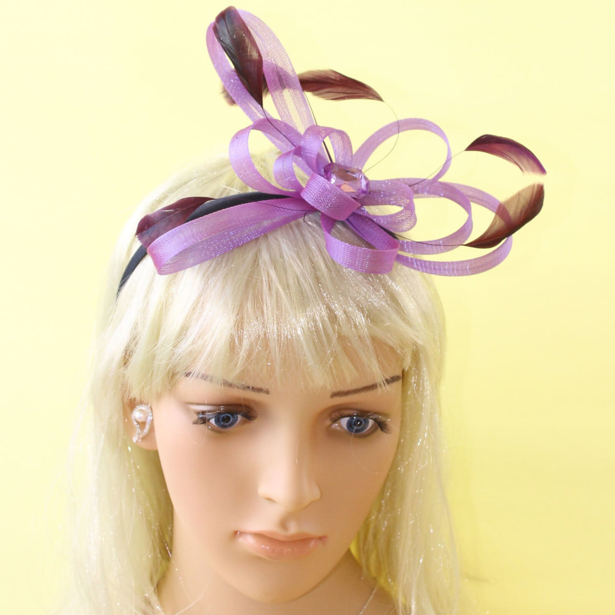 Purple fascinator with looped ribbon, black feathers and gem on black aliceband