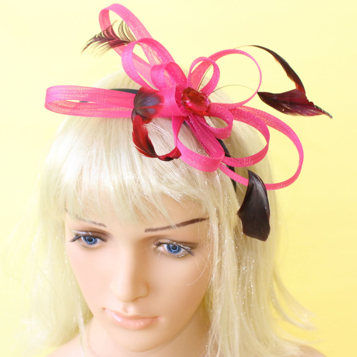 Pink fascinator with loops, gem and feathers on a black aliceband 1