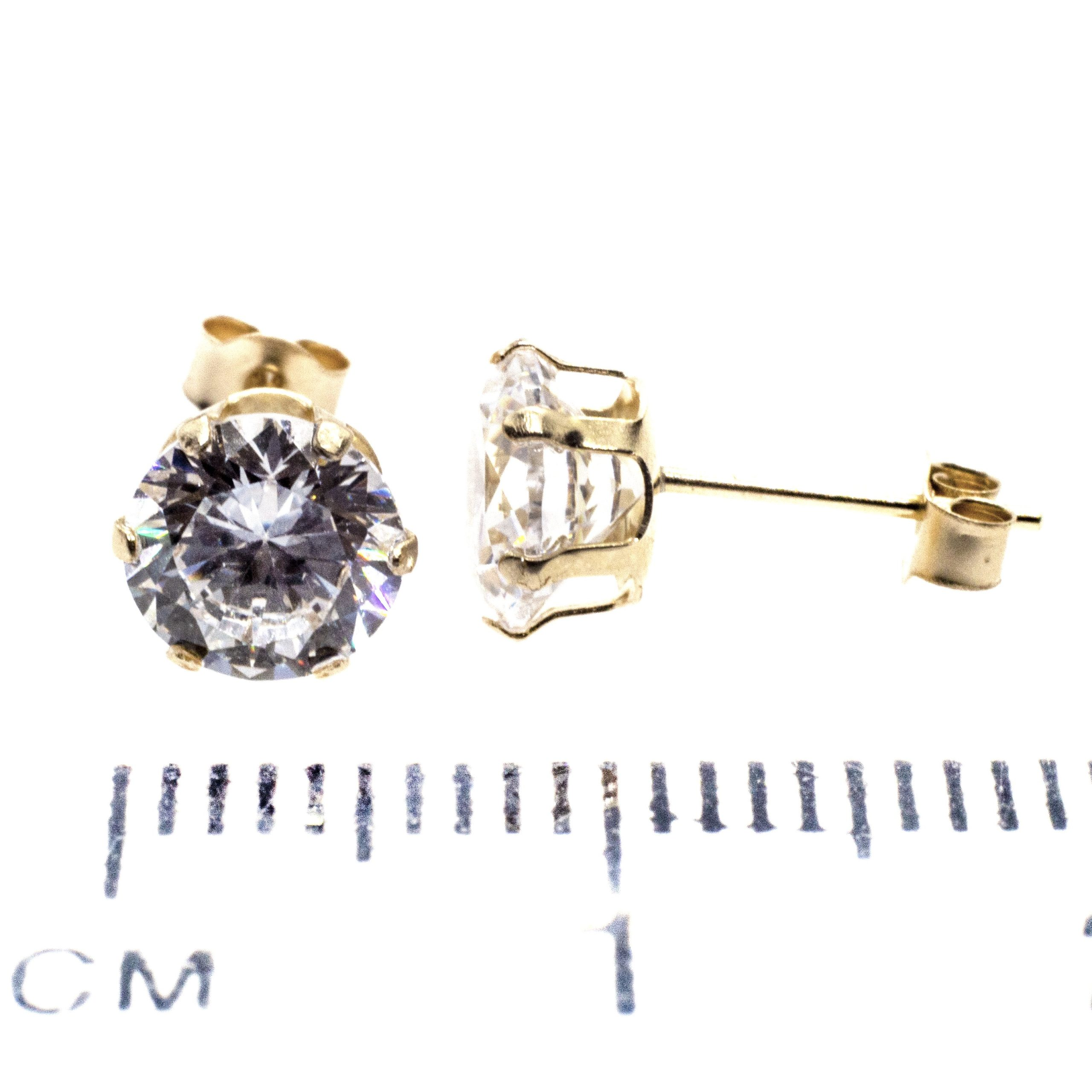 6mm CZ stud earrings 9ct yellow gold ruler