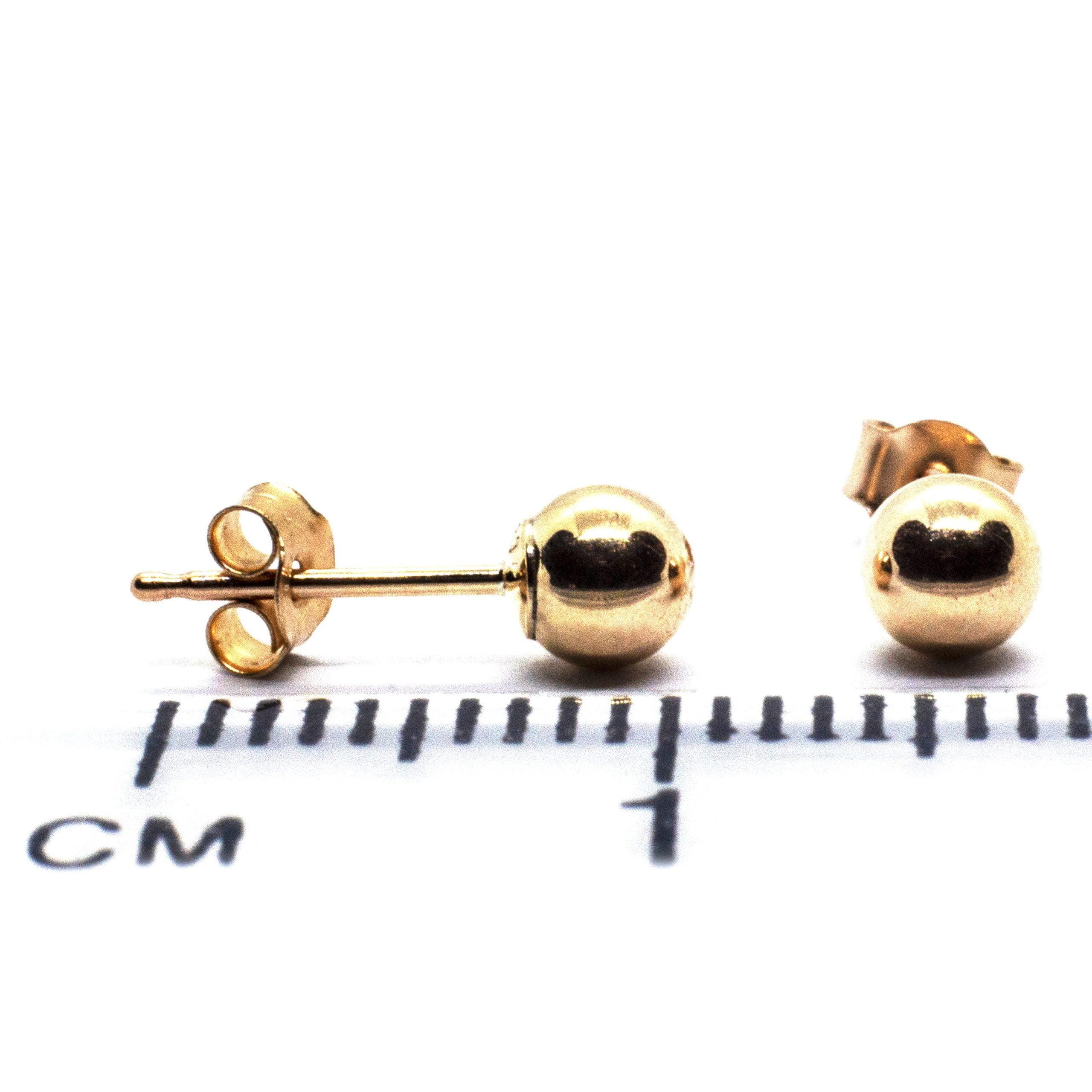 4mm 9ct gold ball earrings ruler