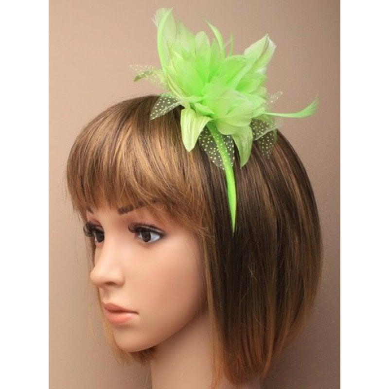 Green fascinator on model
