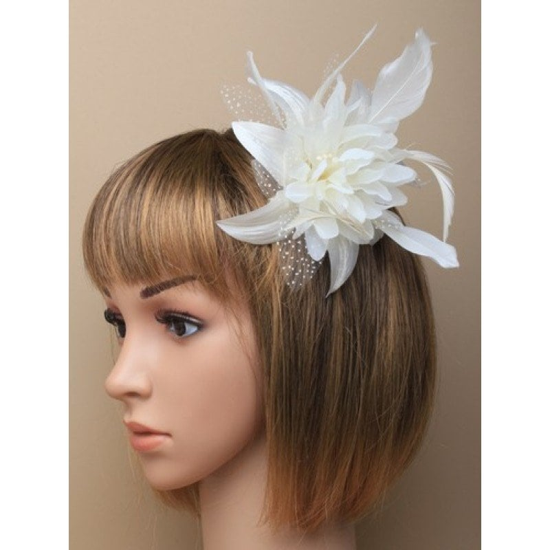 Cream fascinator on model