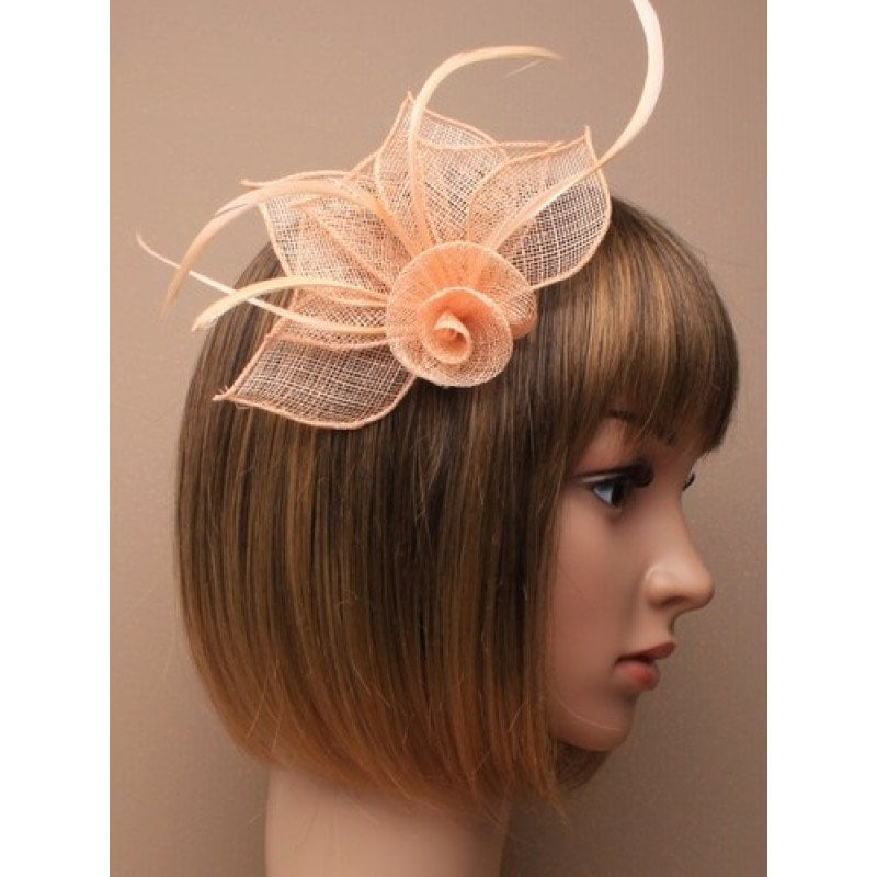 Peach fascinator on model