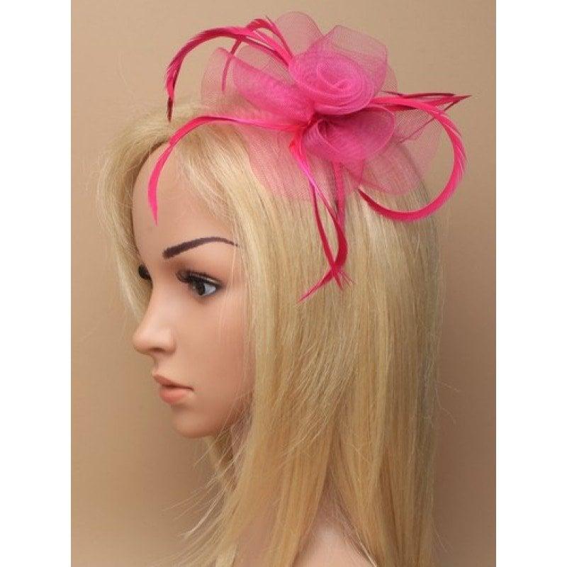 Pink fascinator on model