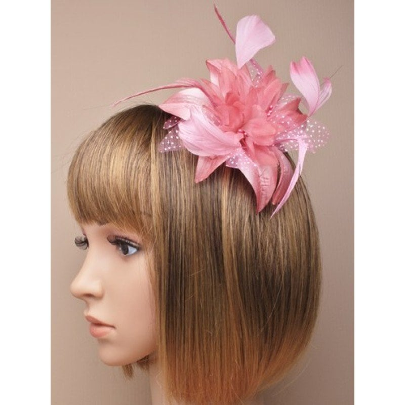 Dusky pink fascinator on model
