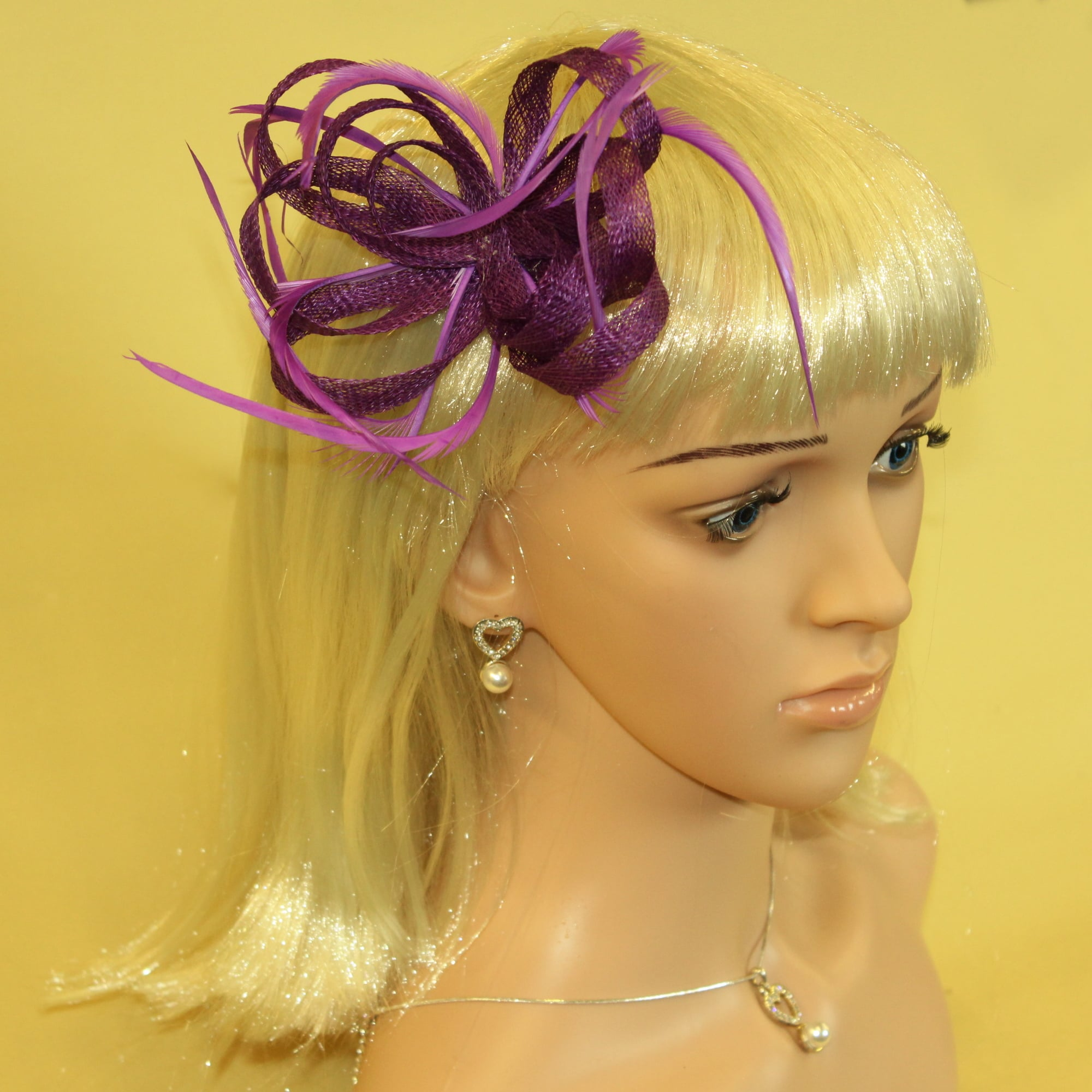Purple fascinator with loops and feathers. Beak clip and brooch pin.