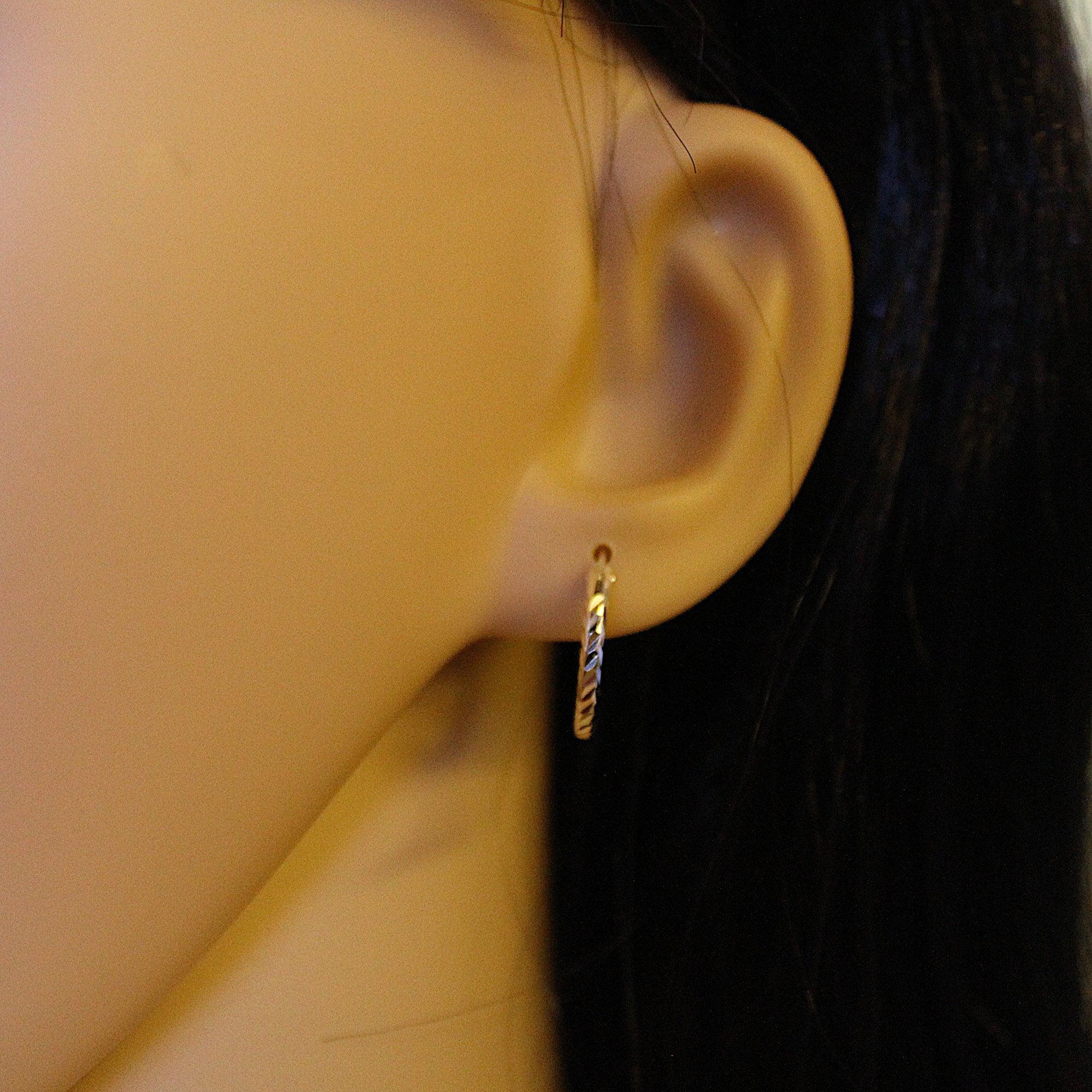c9da0713200436 16mm diamond cut silver hoop earrings · 16mm silver hoops on model