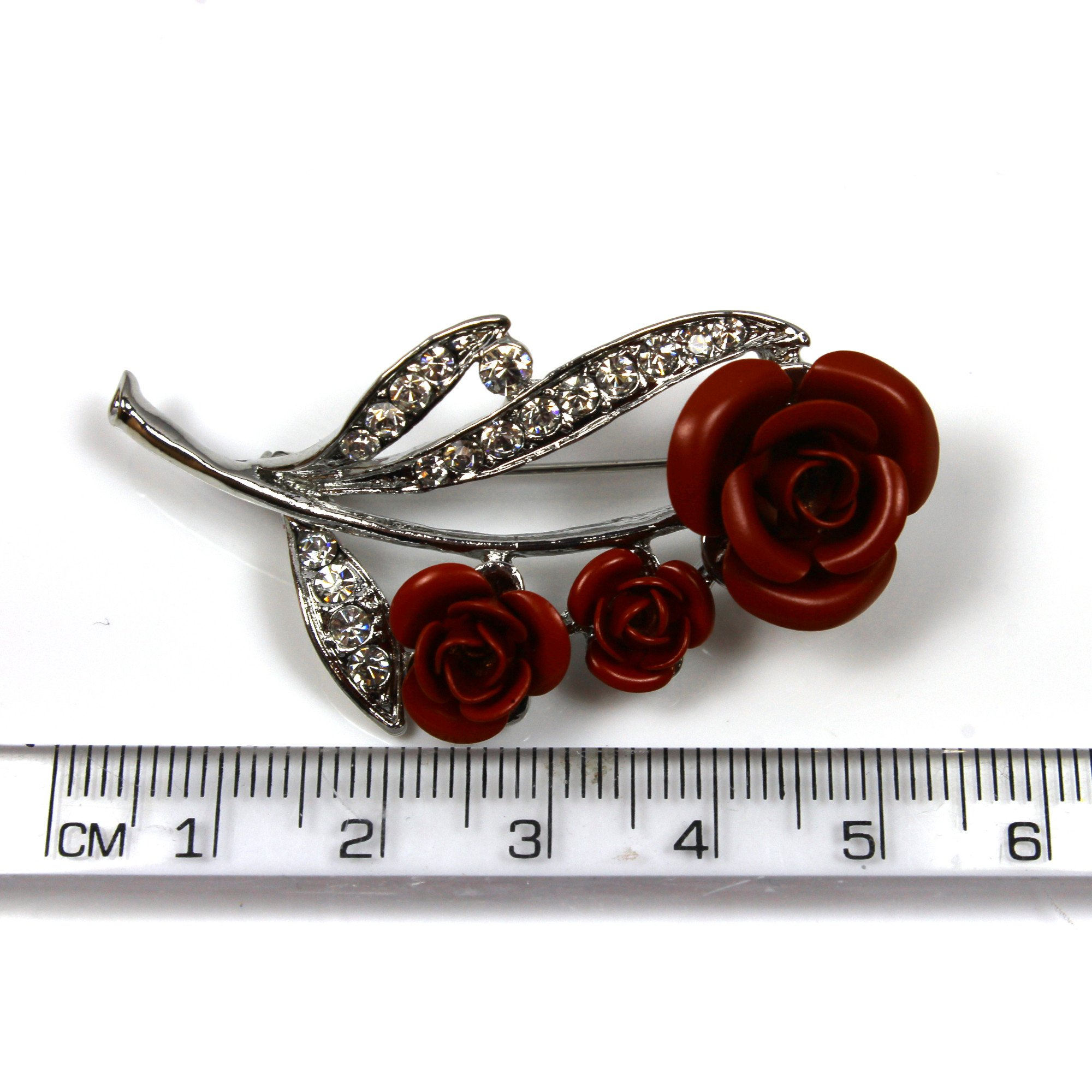 Red rose brooch with ruler