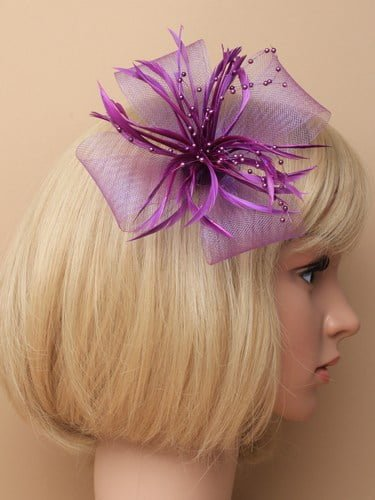 Purple fascinator with bows, feathers and beads on clip and pin.