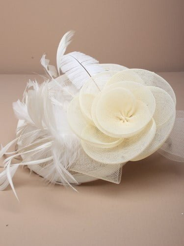 Ladies cream fascinator. Simulated net flower and feathers on an alice band.