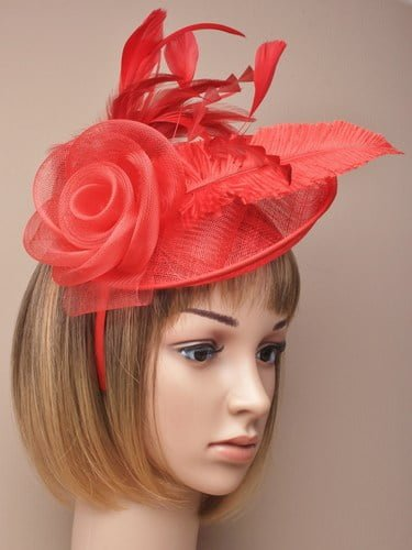 Ladies large red fascinator with feathers and net flower on an alice band.