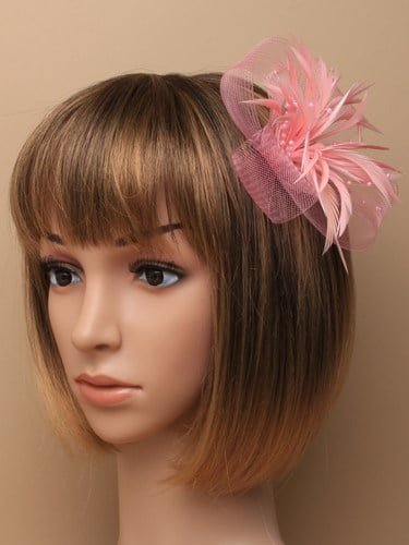 Pink fascinator with net loops and feathers. Beak clip and pin fastenings.