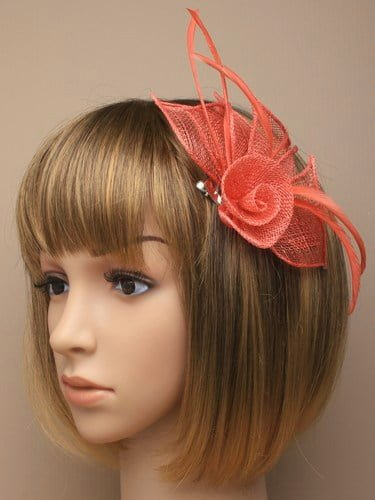 Coral fascinator with flower and feathers. Beak clip and pin.