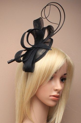 Ladies black fascinator with net loops and ostrich quills on alice band.
