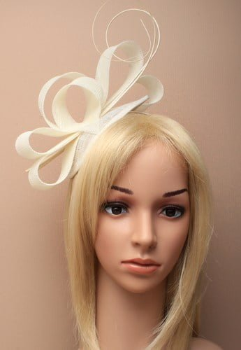 Ladies cream fascinator on alice band. Oval shaped cap with net loops and ostrich quills.