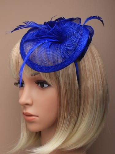 Royal blue fascinator with feathers and flowers on aliceband.