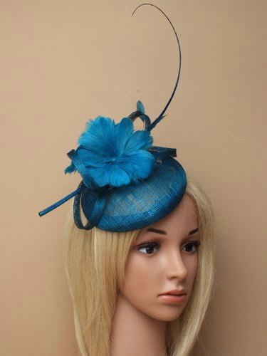 Kingfisher blue fascinator with feather flowers and quill on aliceband.