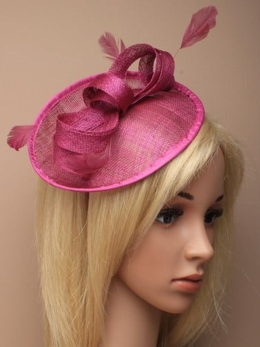 Pink fascinator with bow and feathers on aliceband.