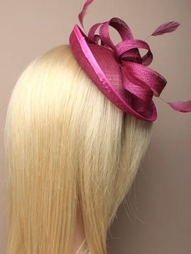 Pink fascinator with bow and feathers on aliceband. (alt 2)