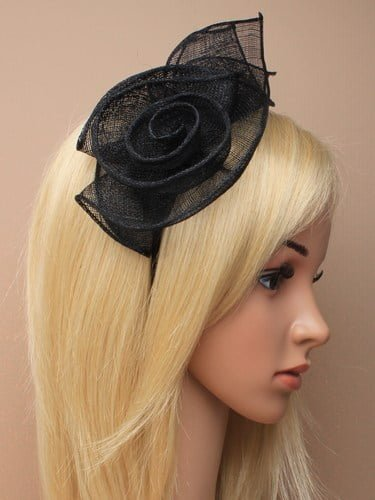 Black fascinator with flower and leaves on aliceband.