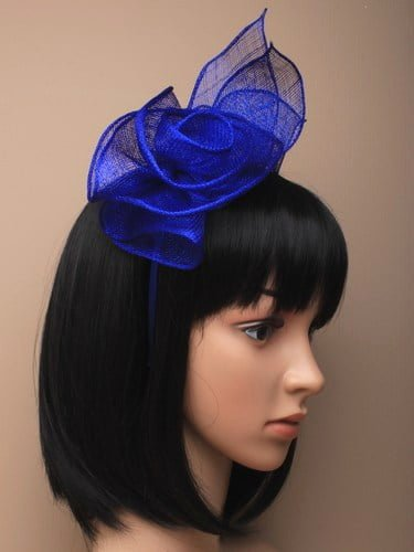 Royal blue fascinator with rose and leaves on aliceband.