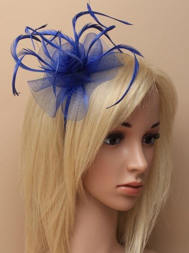 Royal blue fascinator with flower and feathers on aliceband.