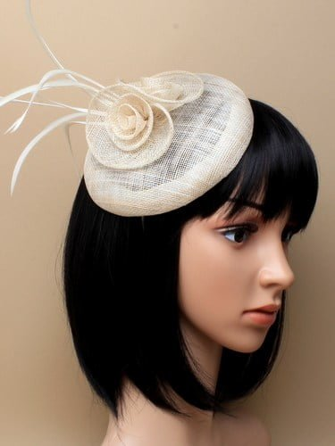 Ivory cap fascinator with flower and feathers on aliceband.