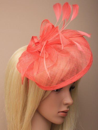 Large coral fascinator with bows, leaves and feathers on an aliceband. (alt 1)