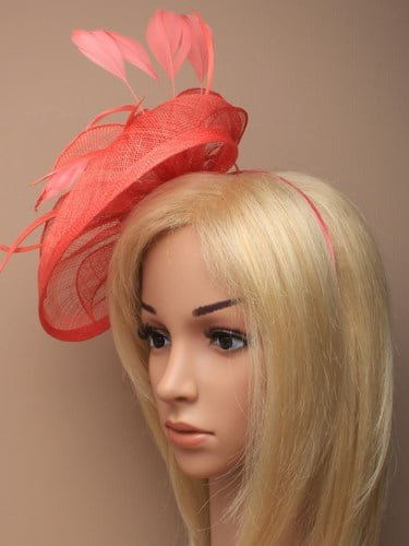 Large coral fascinator with bows, leaves and feathers on an aliceband. (alt 2)